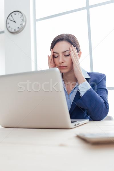 Businesswoman having an headache Stock photo © stokkete