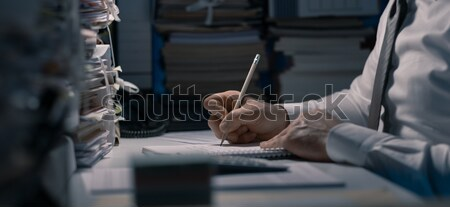 Office worker working late in the office Stock photo © stokkete