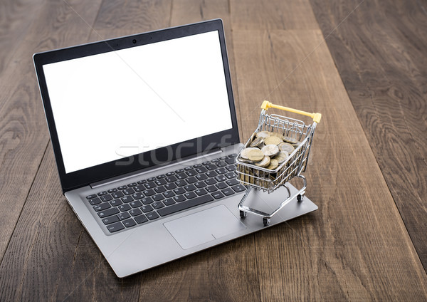 Bevásárlókocsi tele pénz laptop fából készült asztali Stock fotó © stokkete