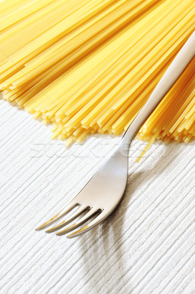 Stock photo: uncooked spaghetti noodles . Italian pasta