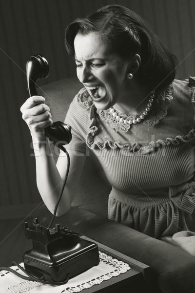 Zły kobieta krzyczeć retro telefonu Zdjęcia stock © stokkete