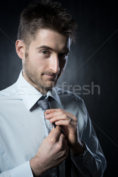 Adjusting necktie Stock photo © stokkete