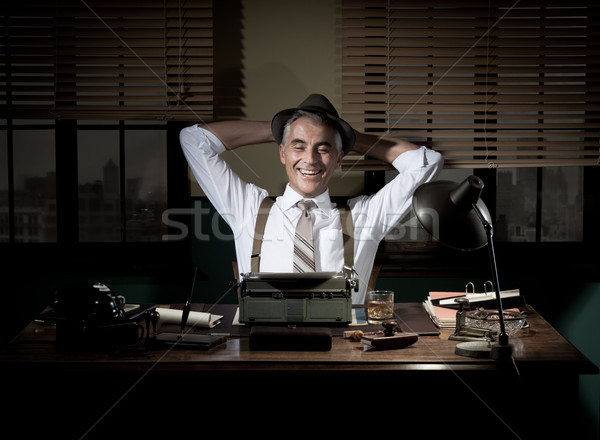 Happy journalist having a break late at night Stock photo © stokkete