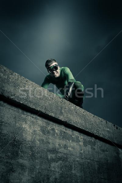 Superhero escaping danger Stock photo © stokkete