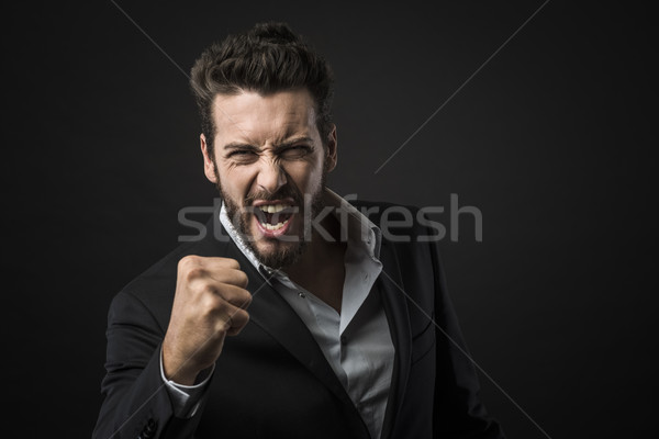 Angry businessman showing fists Stock photo © stokkete