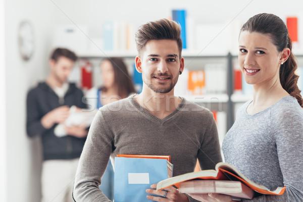 позируют книгах улыбаясь изучения вместе Сток-фото © stokkete
