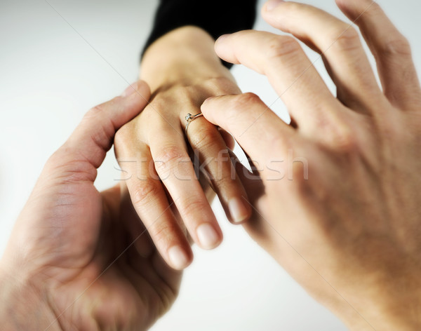 man putting a  ring with a brilliant on a female hand, love conc Stock photo © stokkete