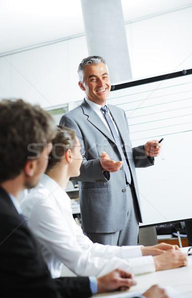 бизнеса презентация улыбаясь бизнесмен планов Сток-фото © stokkete