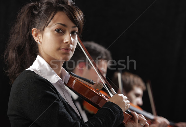 Stock photo: Portrait of young woman violinist