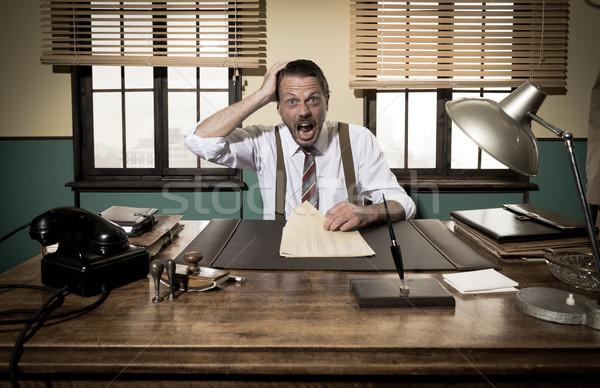 Megrémült üzletember papírmunka klasszikus nyitott szájjal dolgozik Stock fotó © stokkete