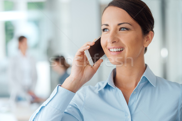 Smiling business woman on the phone Stock photo © stokkete