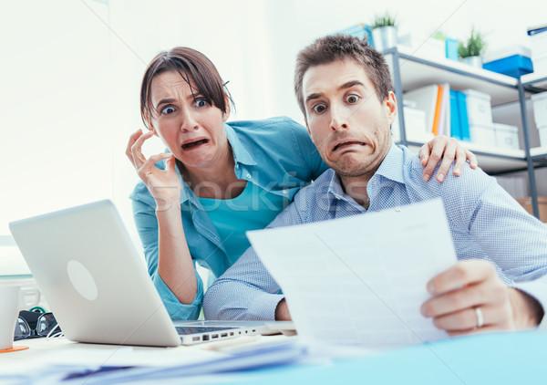 Stressed couple checking bills Stock photo © stokkete