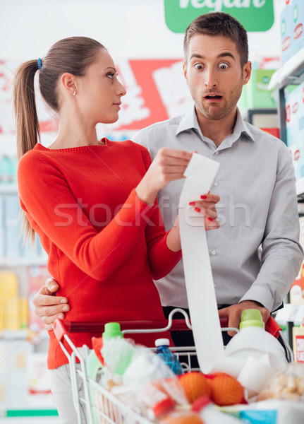 Couple shopping and checking a receipt Stock photo © stokkete
