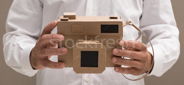 Photographer holding a cardboard camera Stock photo © stokkete