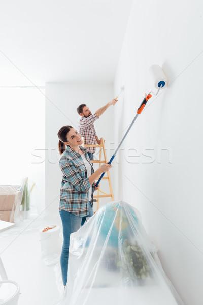 Otthon átalakítás rendbehoz fiatal boldog pár Stock fotó © stokkete