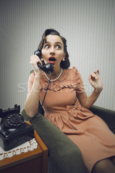 Woman talking on phone, looking surprised Stock photo © stokkete