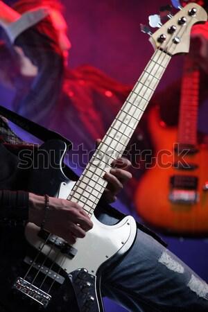 Közelkép kezek játszik basszus férfiak kő Stock fotó © stokkete