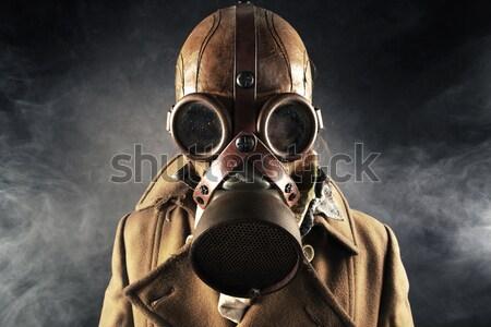 Grunge portre adam tabanca gaz maskesi maske Stok fotoğraf © stokkete