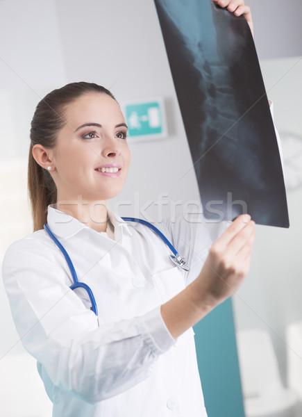 Female doctor checking xray image Stock photo © stokkete