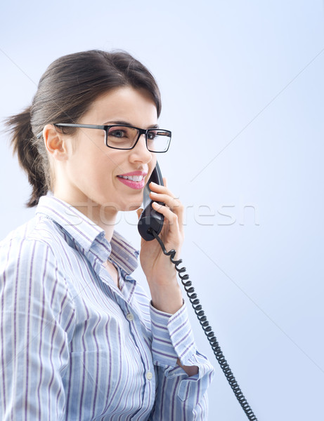 Attractive woman on the phone Stock photo © stokkete