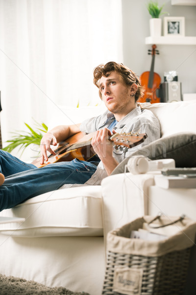 Songwriter composing a song Stock photo © stokkete