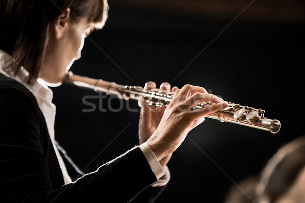 Female flutist performing Stock photo © stokkete