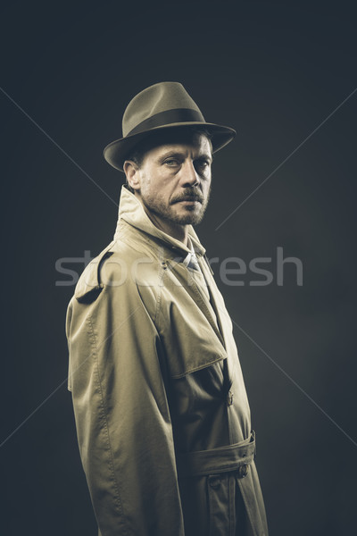 Confident agent in trench coat, film noir Stock photo © stokkete