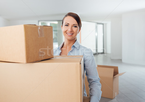 Stock photo: Young woman carrying carton boxes