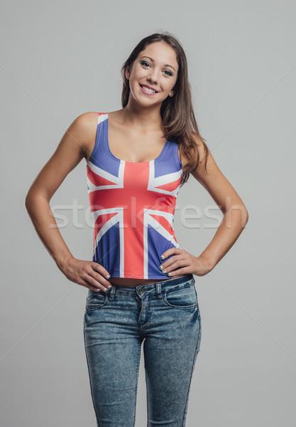 Bella britannico ragazza posa braccia indossare Foto d'archivio © stokkete