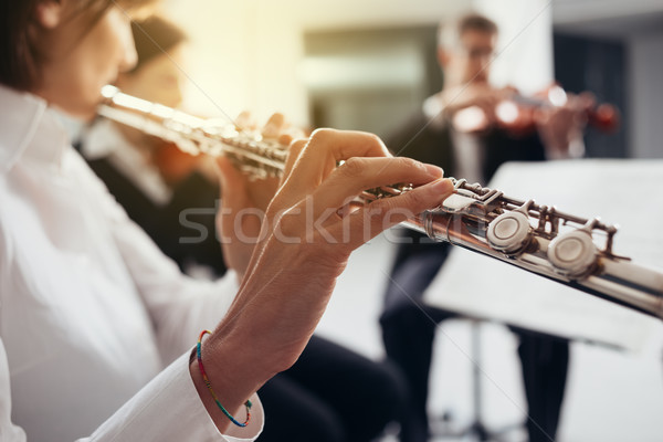Flutist playing her instrument on stage Stock photo © stokkete