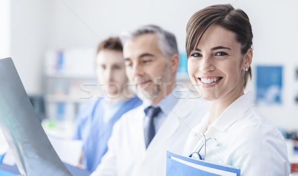 Stock photo: Medical team examining an x-ray