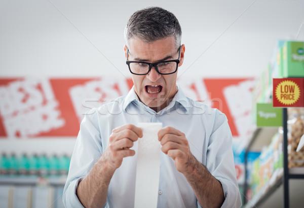 Homme longtemps réception épicerie Shopping Photo stock © stokkete