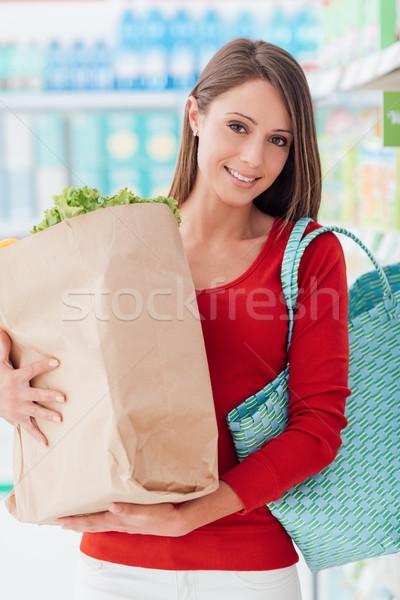 Woman buying fresh vegetables Stock photo © stokkete