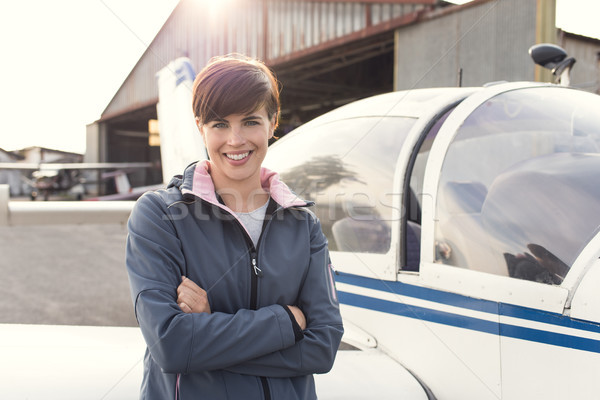 Smiling woman at the airport with light aircraft Stock photo © stokkete