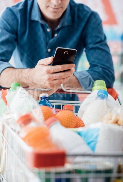 Stock photo: Man shopping and using mobile apps