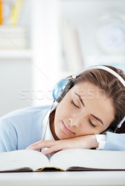 Házi feladat női diák alszik hallgat zene Stock fotó © stokkete
