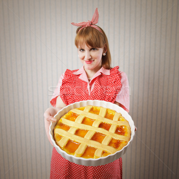 Beautiful woman holding italian pie. Stock photo © stokkete