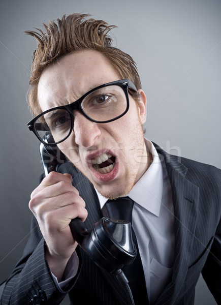 Angry nerd businessman Stock photo © stokkete