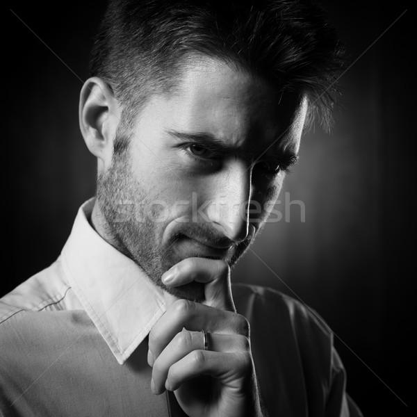 Vonzó fiatal üzletember néz kamera megérint Stock fotó © stokkete