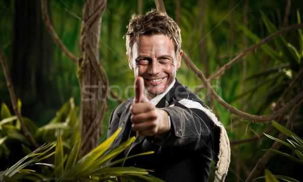 Winning adventurer businessman thumbs up Stock photo © stokkete