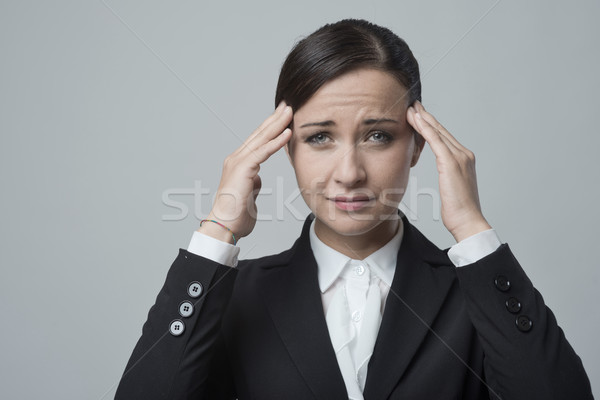 Businesswoman with headache Stock photo © stokkete