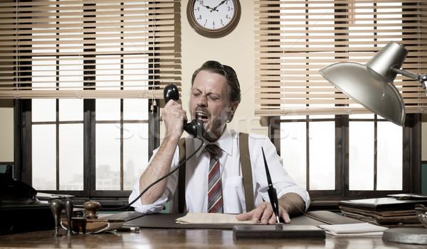 Enojado vintage empresario teléfono de trabajo Foto stock © stokkete