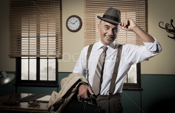 Smiling businessman going home Stock photo © stokkete