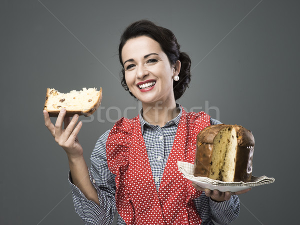 Woman in apron eating panettone Stock photo © stokkete