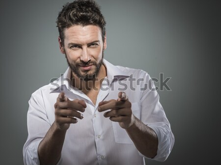 Attractive man getting ready to go out Stock photo © stokkete