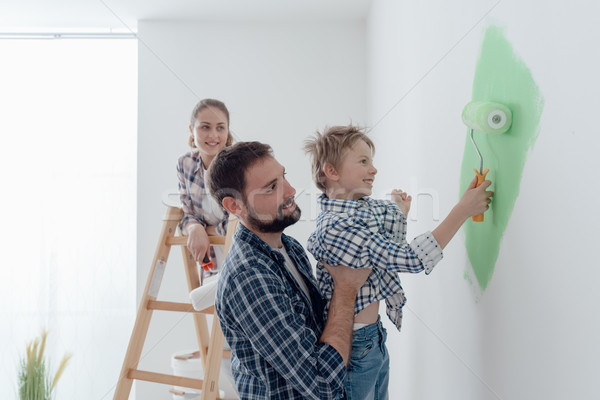 Family painting a room together Stock photo © stokkete
