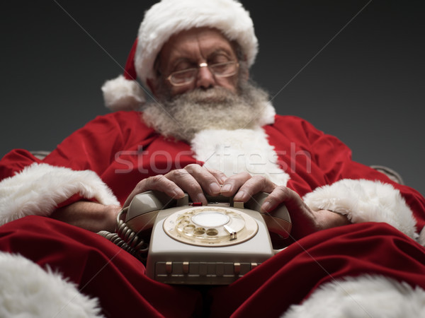 Santa Claus falling asleep while waiting for a phone call Stock photo © stokkete