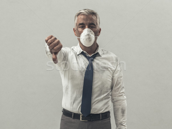 Businessman with pollution mask Stock photo © stokkete