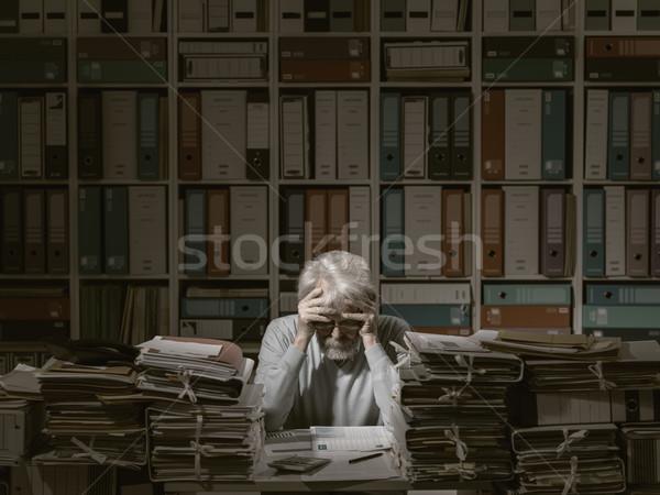 Overloaded senior office worker Stock photo © stokkete
