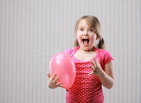 Beautiful little girl making funny face Stock photo © stokkete